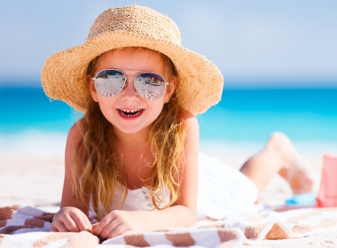 Girl smiling on the beach